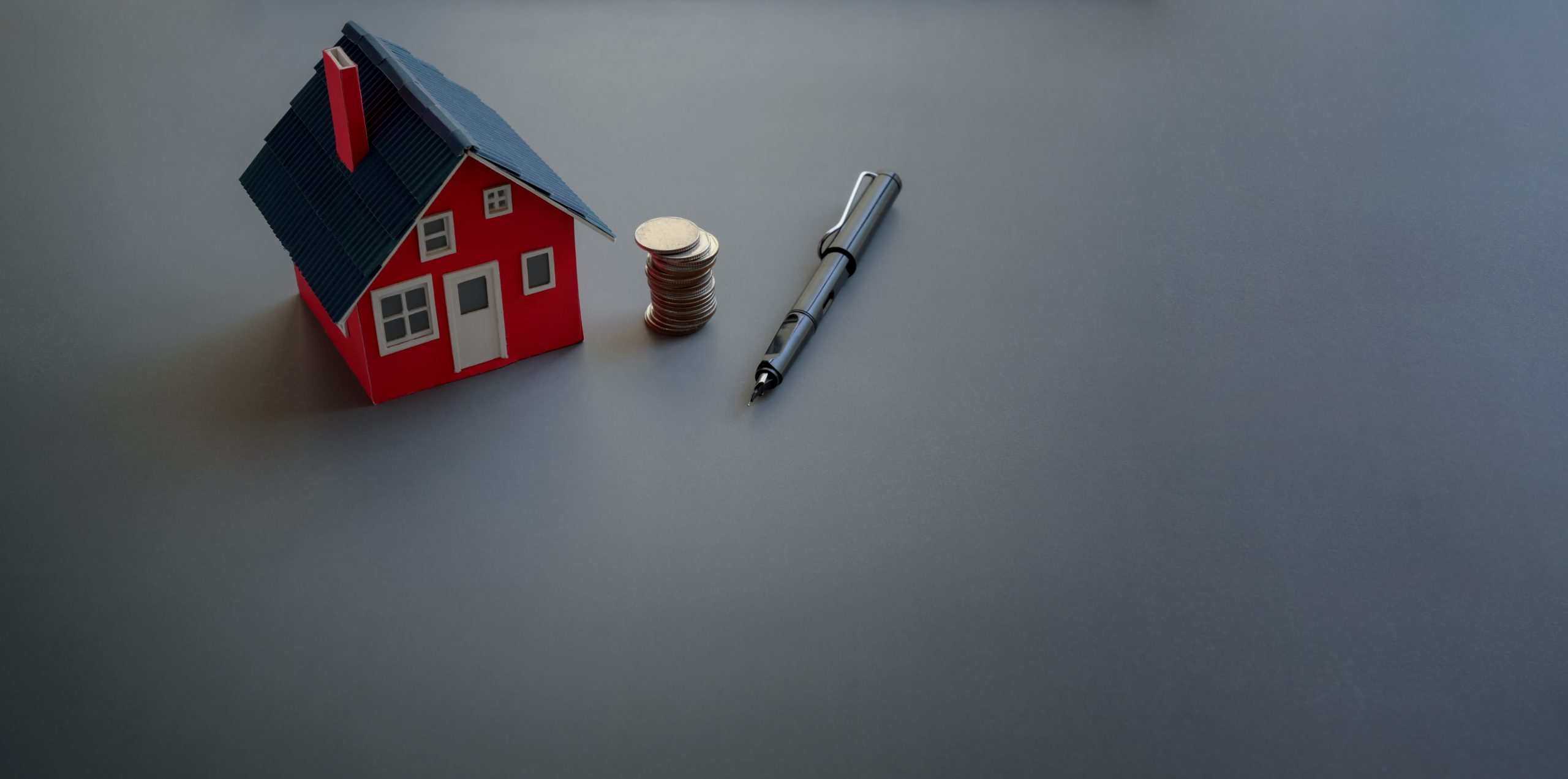 Real estate and property investment concept with small house model